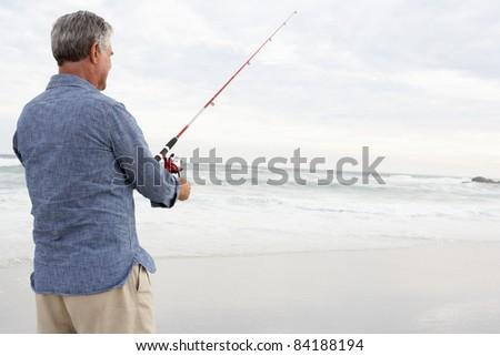 Senior man fishing in sea - stock photo
