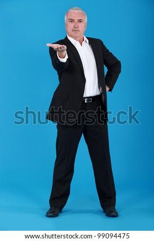 Senior man gesturing - stock photo