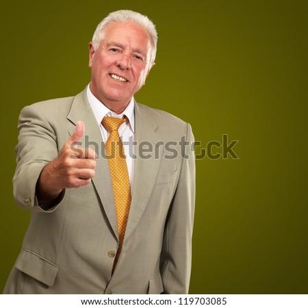Senior Man Gesturing On Green Background - stock photo