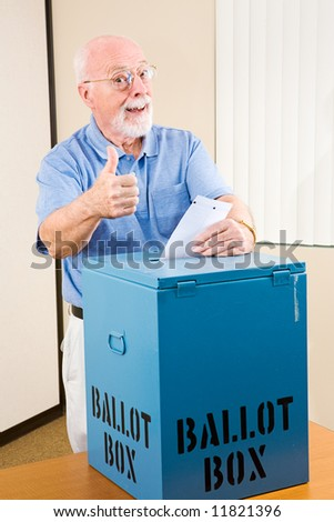Senior man giving the thumbs-up sign as he casts his ballot. - stock photo
