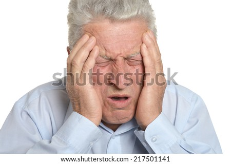 Senior man has a headache on a white background