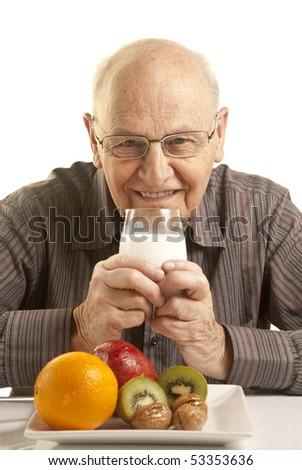 Senior man having a healthy breakfast isolated on white - stock photo