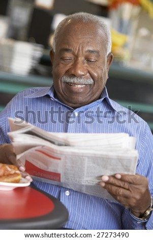 Senior man having morning tea - stock photo