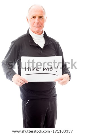 """Senior man holding a message board with the text words """"Hire me"""" - stock photo"""