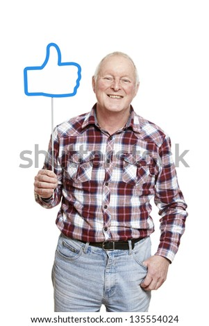 Senior man holding a social media sign smiling on white background