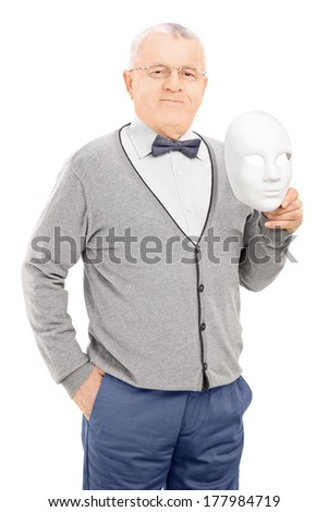 Senior man holding a theater mask isolated on white background - stock photo
