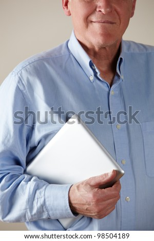 Senior man holding tablet