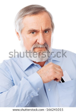 Senior man holding up a cash card Isolated on white background