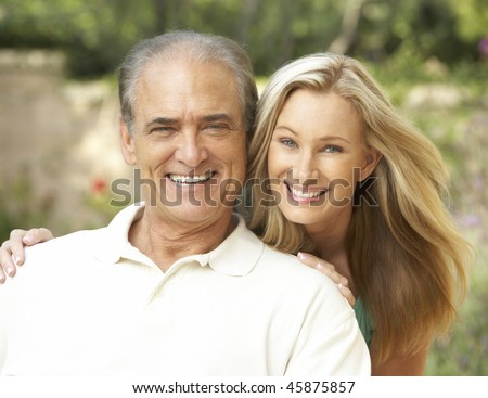 Senior Man Hugging Adult Daughter