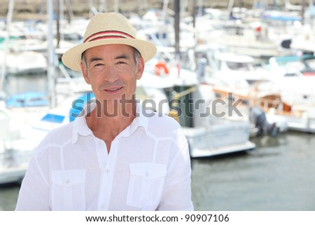 Senior man in front of port - stock photo