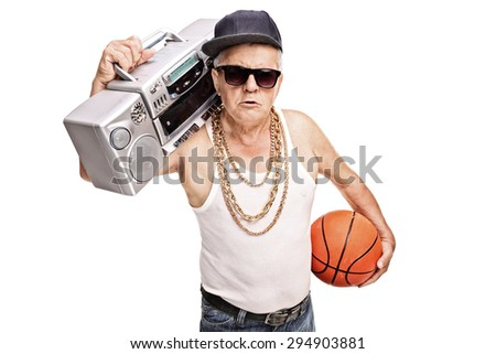 Senior man in hip hop outfit holding a ghetto blaster and a basketball isolated on white background - stock photo
