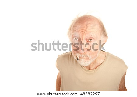 Senior man in ragged shirt smoking the stub of a cigarette