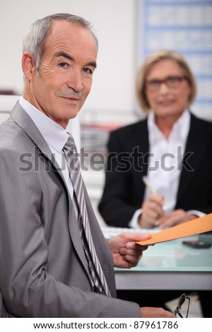 Senior man in recruitment interview - stock photo