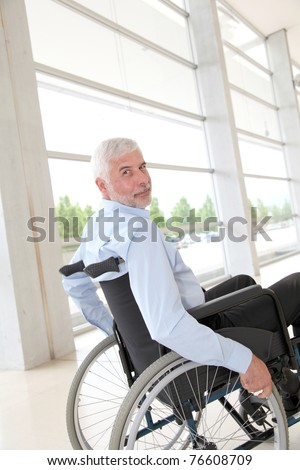 Senior man in wheelchair - stock photo