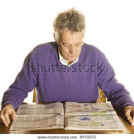 Senior man is reading news-papers