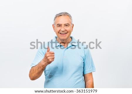 Senior man is showing thumb up.Happy senior man with thumb up - stock photo