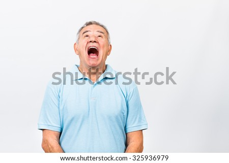 Senior man is very angry because of something and he is screaming.Angry senior man screaming - stock photo