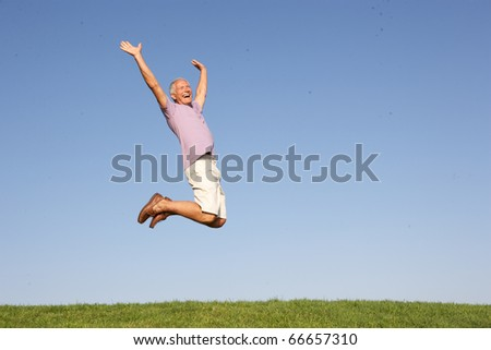 Senior man jumping in air - stock photo