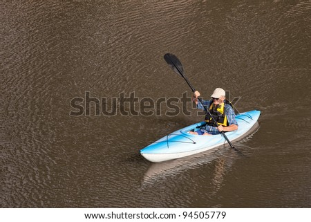 Senior Man Kayaking on Lake