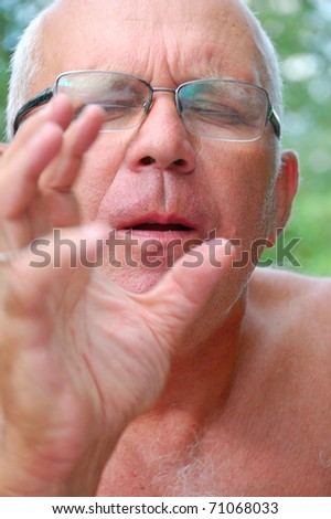 senior man listening to music with the face expression of inspiration - stock photo