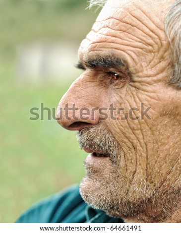 Senior man looking off into distance - profile - stock photo