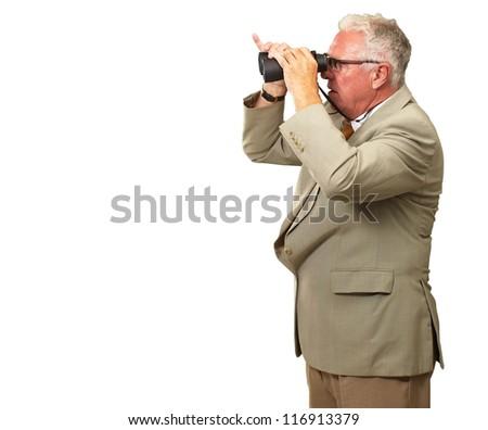 Senior Man Looking Through Binoculars On White Background - stock photo
