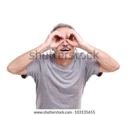 Senior man  looking through imaginary binocular - stock photo