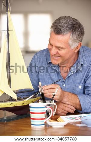 Senior man model making - stock photo