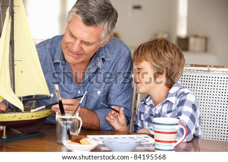 Senior man model making with grandson - stock photo