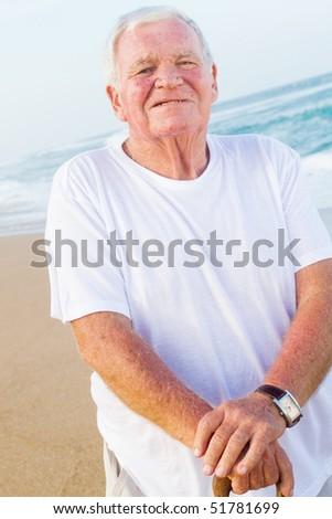 senior man on beach - stock photo