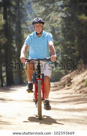 Senior man on country bike ride - stock photo