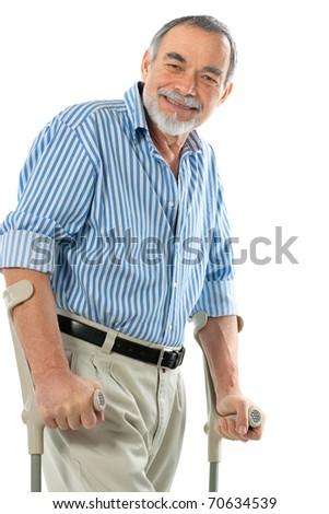 senior man on crutches smiling - stock photo