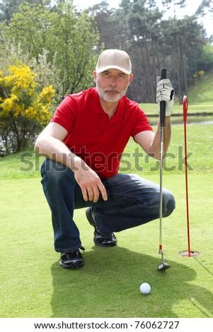 Senior man on golf course - stock photo