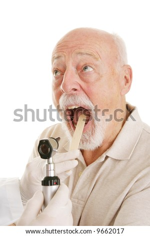 Senior man opening his mouth for the doctor to look in his throat.  White background. - stock photo