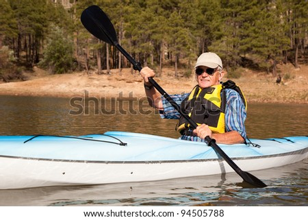 Senior Man Paddling Kayak