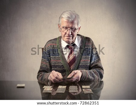 Senior man playing solitaire