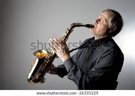 senior man playing the saxophone - stock photo