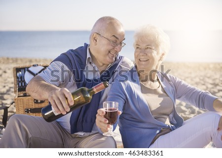 Senior man pouring red wine