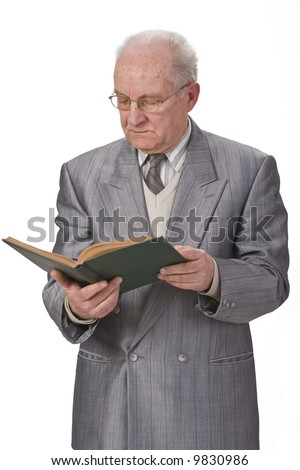 Senior man reading a book against a white background.