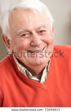 Senior Man Relaxing In Chair At Home - stock photo