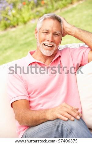 Senior Man Relaxing In Garden - stock photo