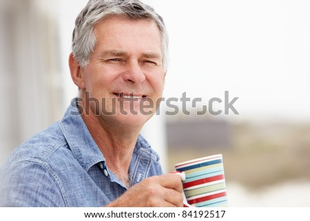 Senior man relaxing outdoors - stock photo