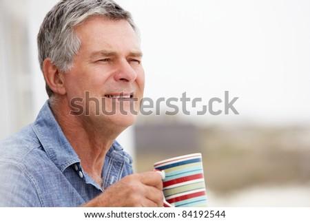 Senior man relaxing outdoors - stock photo