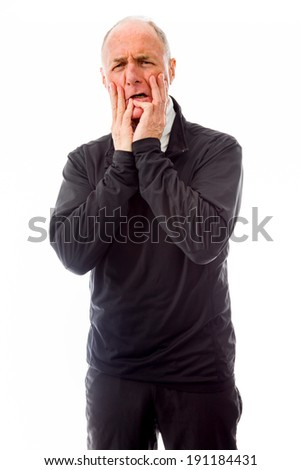 Senior man scared with head in hands - stock photo