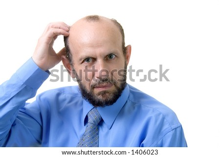 Senior man scratches his head - he is frustrated - stock photo
