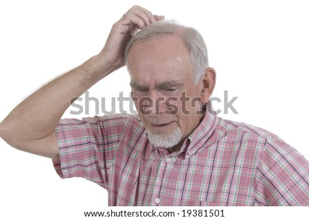 Senior man scratching his head in puzzlement, trying to solve a problem - stock photo