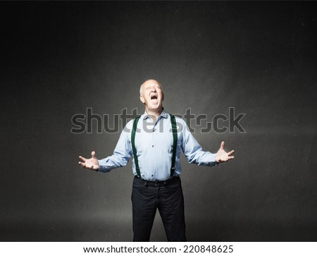 senior man screaming and gesturing with open arms - stock photo