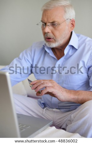 Senior man shopping on internet