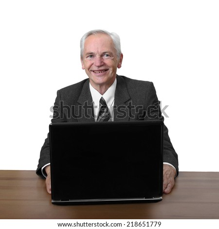 Senior man sits at notebook with a smile on his face isolated on white background