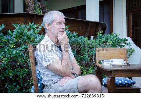 senior man sitting and drinking coffee in the morning at home.